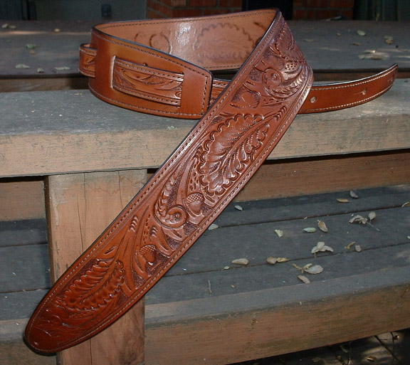 Hand tooled leather motorcycle grips