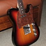 custom Telecaster with hand-engraved parts, hand-tooled leather pickguard