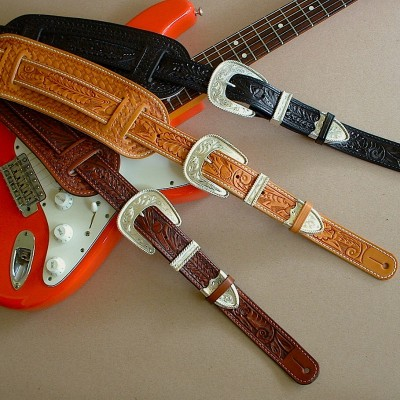 Original Model leather guitar straps in tan, brown, and black